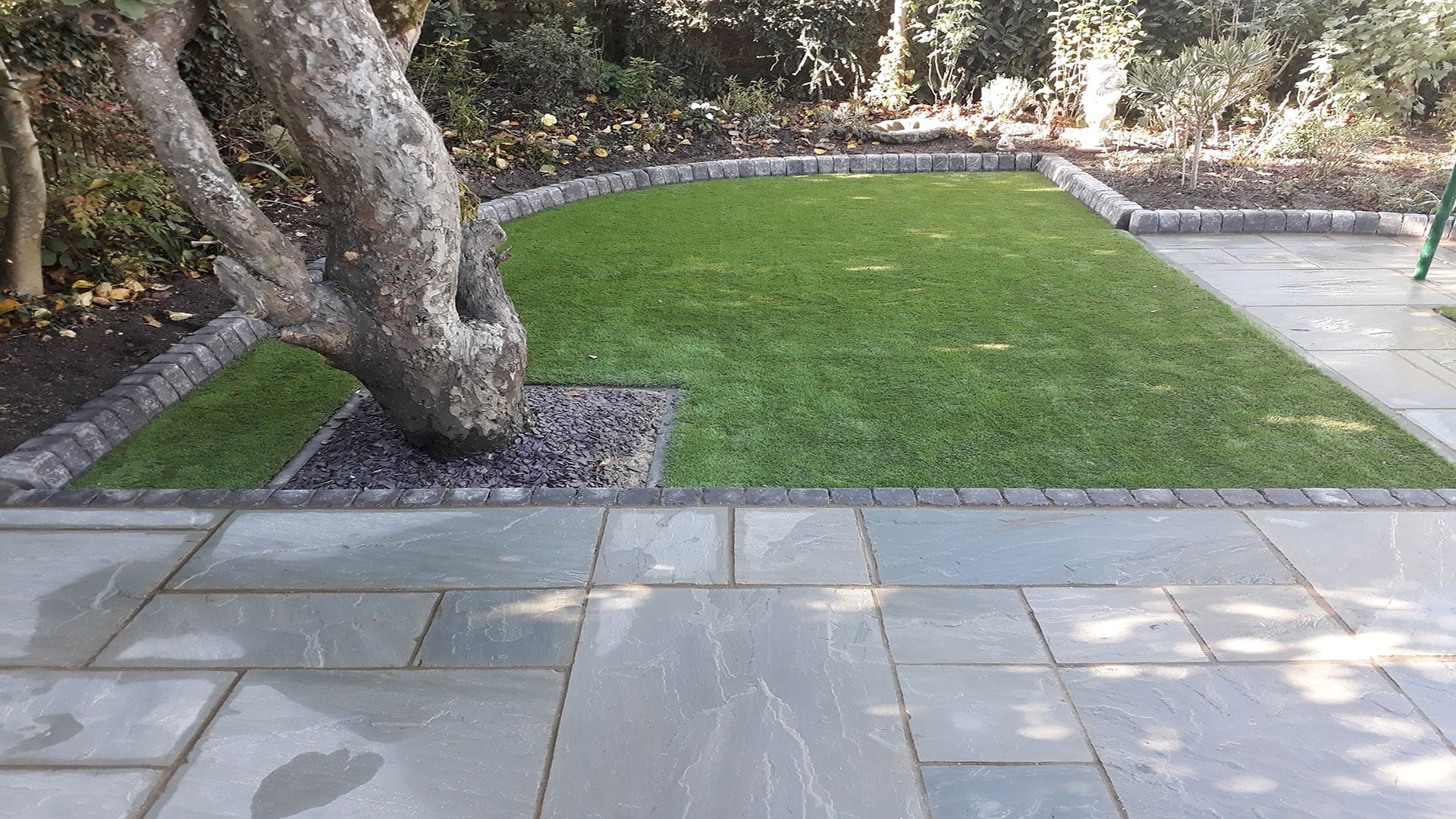 After Photo of the New Patio, Path and Artificial Grass